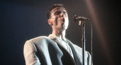 "David Byrne of Talking Heads, singing ""Once in a Lifetime"" How did I get here?"