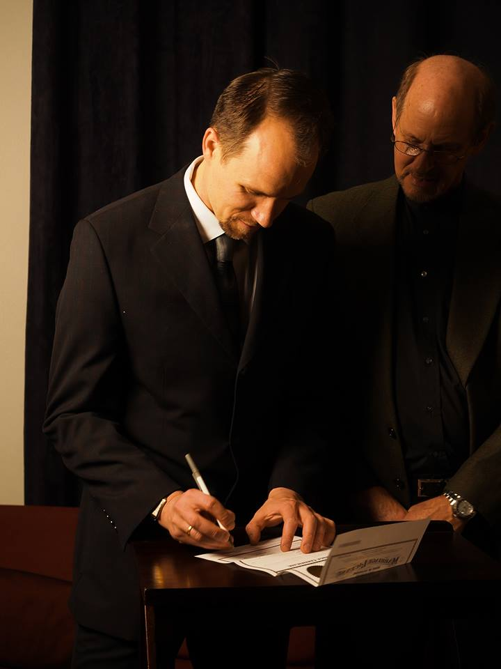 Reed and Marshall Summers - Reed is filling out the marriage license - A New Message Marriage