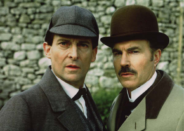 Sherlock Holmes and Dr. Watson, played by Jeremy Brett and David Burke. Behold I tell you a mystery.